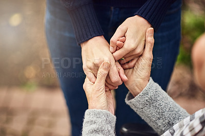 Buy stock photo Cropped shot of two unrecognizable people holding hands