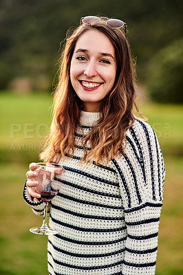 Buy stock photo Portrait of a young woman enjoying a drink outdoors