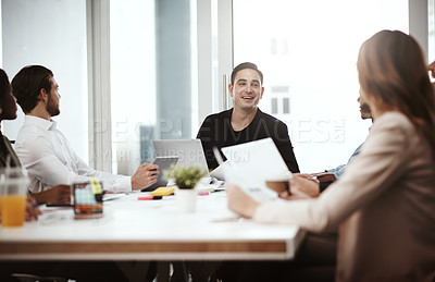 Buy stock photo Shot of a businessman having a meeting with his colleagues in a boardroom