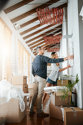 Buy stock photo Shot of a mature couple moving into their new house