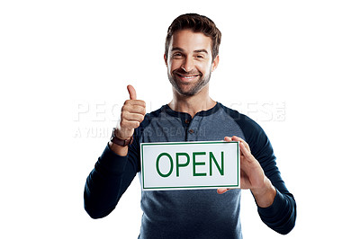 Buy stock photo Studio portrait of a handsome young man holding an open sign against a white background
