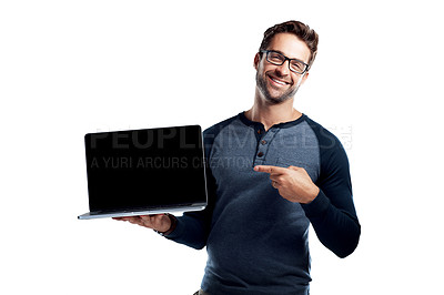 Buy stock photo Studio portrait of a handsome young man holding a laptop with a blank screen against a white background