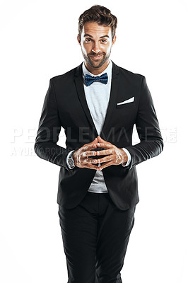 Buy stock photo Studio shot of a handsome young man wearing a tuxedo against a white background
