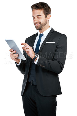 Buy stock photo Studio shot of a handsome young businessman posing against a white background