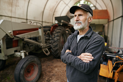 Buy stock photo Shot of a confident mature man standing in the shed on a farm