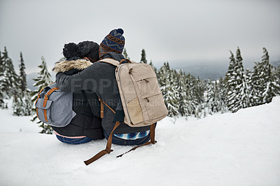 Buy stock photo Rearview shot of a couple admiring the snowy view