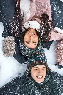 Buy stock photo High angle shot of a happy young couple out on the snow