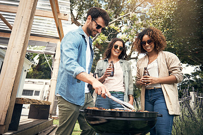 Buy stock photo Shot of a group of friends having a barbecue together