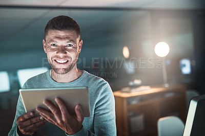 Buy stock photo Portrait of a mature businessman working late on a digital tablet in an office