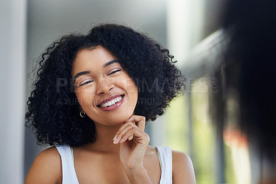 Buy stock photo Shot of a young woman going through her morning routine at home