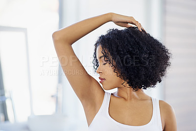 Buy stock photo Cropped shot of a young woman smelling her armpits