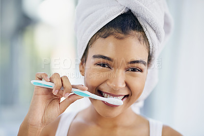 Buy stock photo Cropped shot of a beautiful young woman brushing her teeth at home