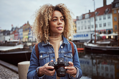 Buy stock photo Shot of an attractive young woman out with her camera in a foreign city