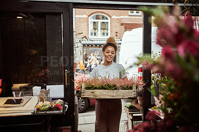 Buy stock photo Cropped shot of an attractive young woman standing in her floral boutique