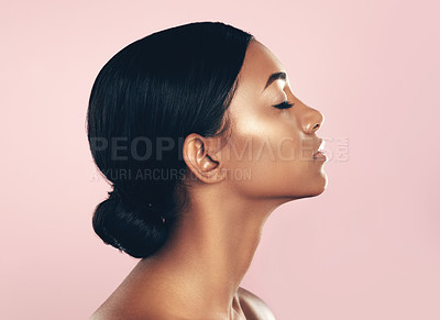 Buy stock photo Studio shot of a beautiful young woman posing with her eyes closed against a pink background