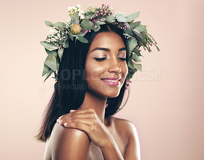 Buy stock photo Studio shot of a beautiful young woman wearing a wreath while posing with her eyes closed against a pink background