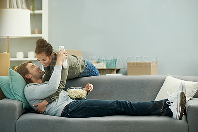 Buy stock photo Shot of a young attractive couple being affectionate in their new home