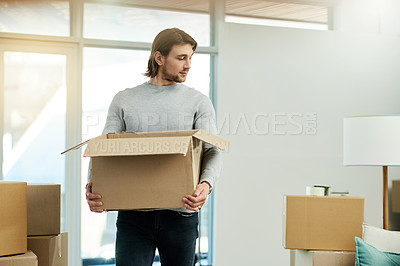 Buy stock photo Cropped shot of a handsome young man in his new home on moving day