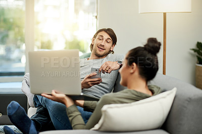 Buy stock photo Cropped shot of a young attractive couple chilling on the sofa together in their new home