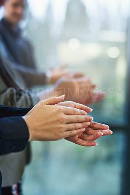 Buy stock photo Cropped shot of a group of unrecognizable businesspeople clapping in an office