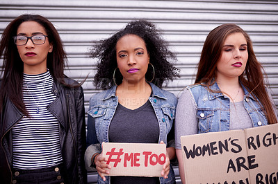 Buy stock photo Cropped shot of women holding posters with different messages while protesting in the city
