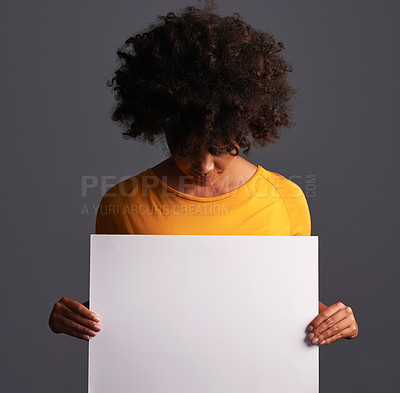 Buy stock photo Studio shot of a beautiful young woman holding up a placard against a grey background