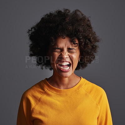 Buy stock photo Shot of a young woman shouting against a grey background