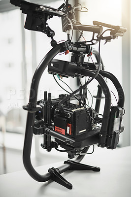Buy stock photo Behind the scenes shot of a state of the art video camera placed on the floor of a studio during the day