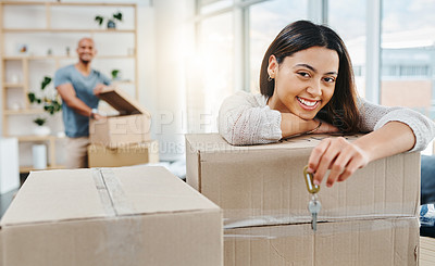 Buy stock photo Portrait of a young woman holding the keys to her new house