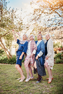 Buy stock photo Full length shot of a group of happy senior women dancing during a hike in the great outdoors