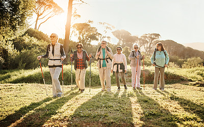 Buy stock photo Full length shot of a group of happy senior women enjoying a hike in the great outdoors