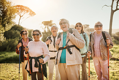 Buy stock photo Cropped portrait of a group of happy senior women enjoying a hike in the great outdoors