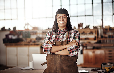 Buy stock photo Cropped portrait of an attractive young woman standing with her arms folded in her creative workshop