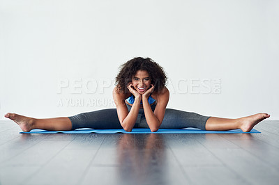 Buy stock photo Studio shot of an athletic young woman practicing yoga against a grey background
