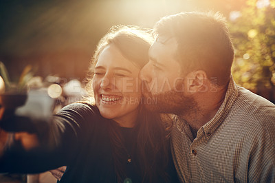 Buy stock photo Cropped shot of a loving couple taking a selfie together