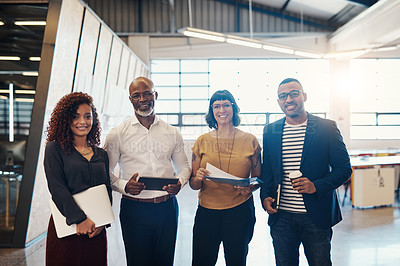 Buy stock photo Portrait of a group of designers standing together in an office