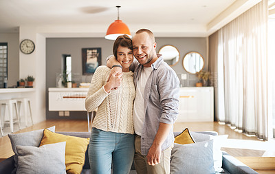 Buy stock photo Portrait of a happy young couple spending quality time together at home