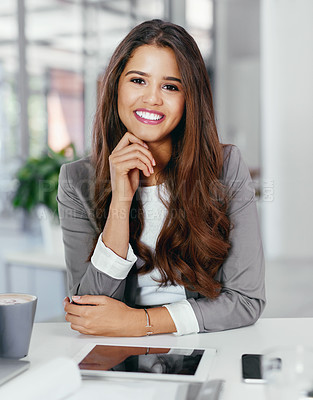 Buy stock photo Cropped portrait of a confident young businesswoman working in an office