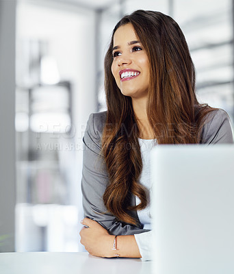 Buy stock photo Cropped shot of a confident young businesswoman looking thoughtful  while working in an office