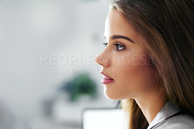 Buy stock photo Cropped profile of a confident young businesswoman in an office
