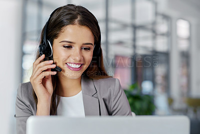 Buy stock photo Cropped shot of a young female call center agent working in an office