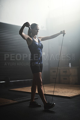 Buy stock photo Shot of an athletic young woman working out in the gym