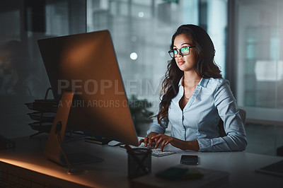 Buy stock photo Cropped shot of an attractive young businesswoman working late in her office