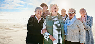 Buy stock photo Portrait of a group of happy senior women having a fun day at the beach