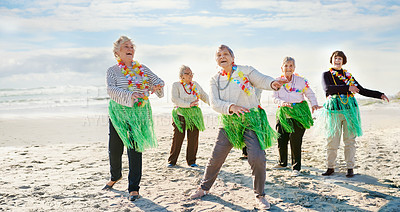Buy stock photo Portrait of a group of happy senior women hula dancing at the beach