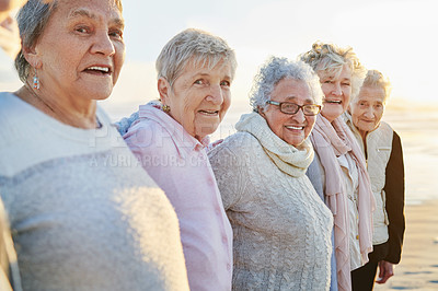 Buy stock photo Portrait of a group of happy senior women taking selfies at the beach