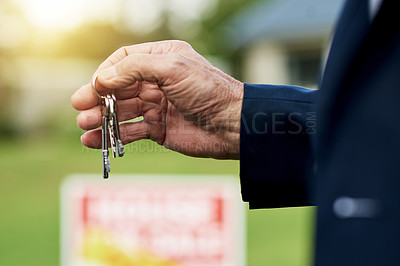 Buy stock photo Cropped shot of a well-dressed man holding up a key