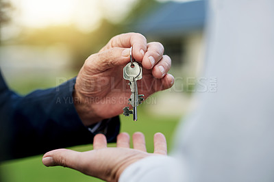 Buy stock photo Shot of an unrecognizable person handing over a key
