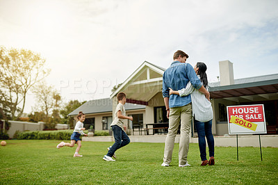 Buy stock photo Shot of a family of four viewing their new home