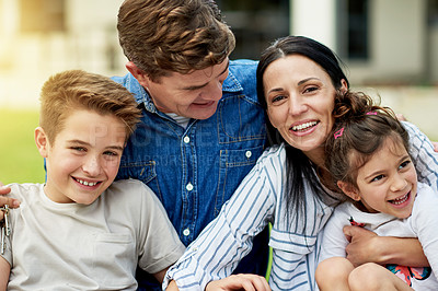 Buy stock photo Cropped shot of a family of four sitting together outside
